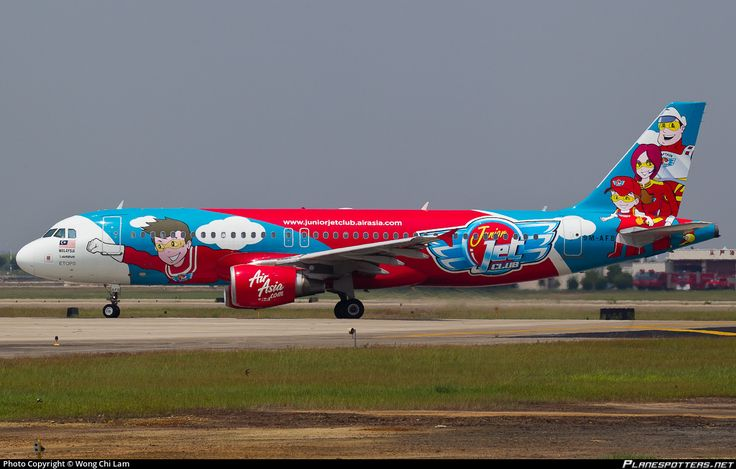 AirAsia (MY) Airbus A320-214 9M-AFB aircraft, painted in ''Junior Jet Club'' special colours Apr, 2010 - 2012, with the mascots of ''Junior-Jessie-Captain John Jet & Jennie Jet'' on the airframe, skating at China Guangzhou Baiyun International Airport. 13/08/2011. (Junior Jet Club=former AirAsia childrens club, now Sky Riders).
