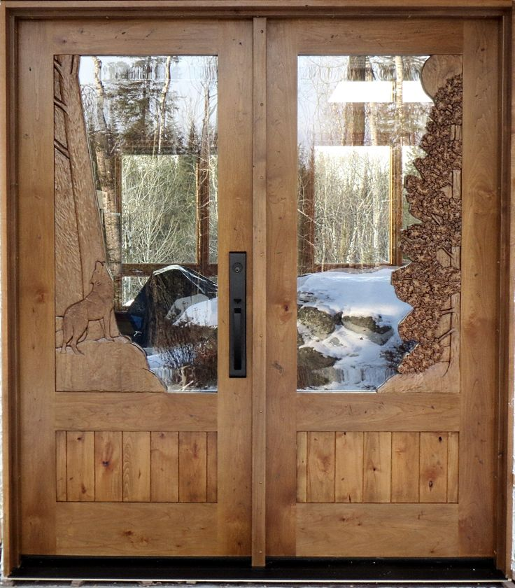 100 best images about windows and exterior doors on for Hand carved wood doors