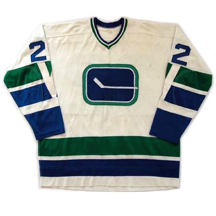 """Vancouver Canucks 1970-71 home jersey The original 1970-71 jersey conceived by local creative designer Joe Borovich. After the first year, the """"V"""" disappeared off the sleeves. This designed lasted eight seasons, highlighted by the club's first divisional title in 1974-75."""