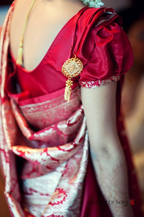Bengali style sari draping! Love the puffy sleeved blouse and the little ornament where traditionally one would hang a ring of keys :)