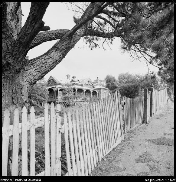 View along picket fence to weatherboard Victorian style residence, Maldon, Victoria, ca. 1970