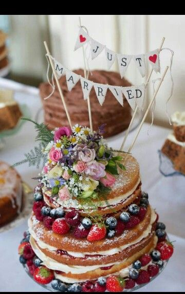 Worth having a wedding just as an excuse for this amazing vintage style naked Victoria sponge cake with berries and flowers with beautiful 'just married' bunting