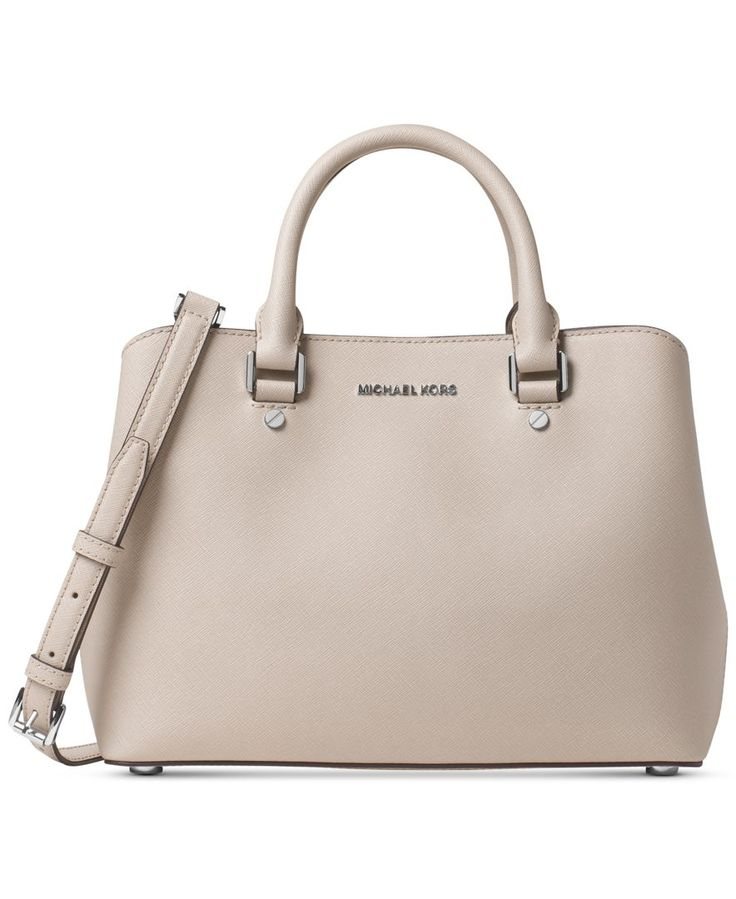 A sophisticated and stunning example of workweek-chic, Michael Michael Kors' medium satchel flaunts a subtly curved shape in saffiano leather. Exceptionally organized, you'll find a selection of intui