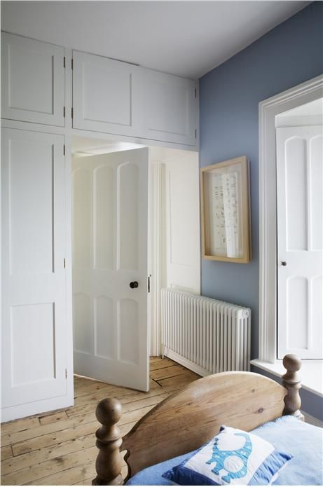 An inspirational image from Farrow and Ball, lulworth blue wall: corridor. Door : wimbourne white