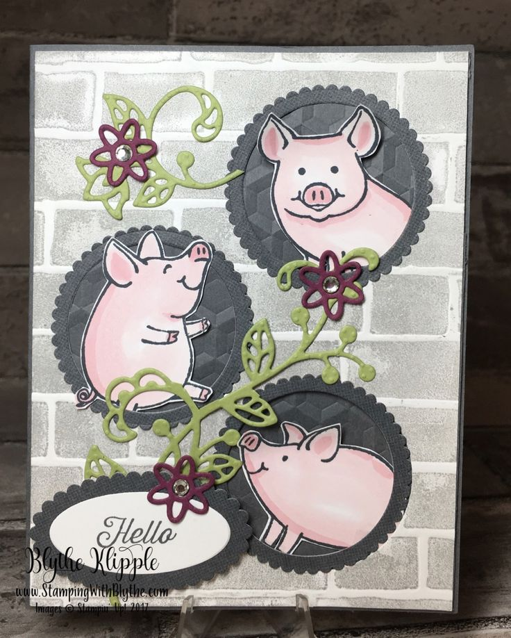 Three little piggies smiling at you from their brick wall windows