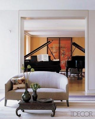 Many would kill to have just one grand piano in their home, but can you imagine two in your studio! Thanks Elle Decor