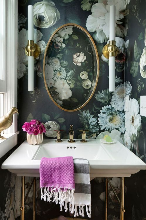 Small spaces like bathrooms or hallways are the perfect place to use bold patterns. This dark and moody floral wallpaper gives this bathroom a really glamorous, but quirky look.