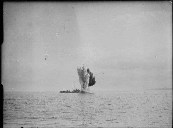 AUG 19 1942 Operation Jubilee – the raid on Dieppe HMS BERKELEY being torpedoed by our own forces after being bombed during the Combined Operations daylight raid on Dieppe. Note how the plume of water caused by the explosion dwarfs the destroyer.