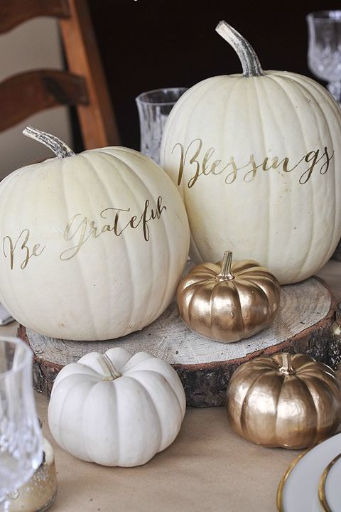 Use a gold Sharpie to draw letters on pumpkins for a simple, pretty centerpiece. Get the tutorial at Your Homebased Mom.