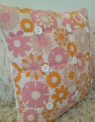 60's Wallpaper Style Quilted cushion with flower buttons.
