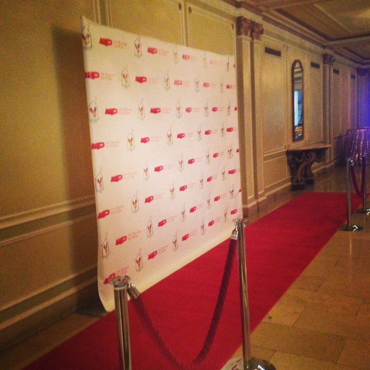 Red carpet step and repeat. VIP. Photo op. Red velvet ropes