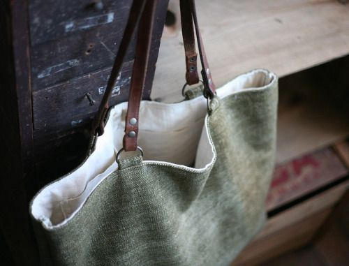 Leather straps on soft linen tote.