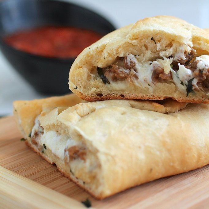 Homemade calzones are easy and delicious - especially these goat cheese, basil, and Italian sausage calzones!