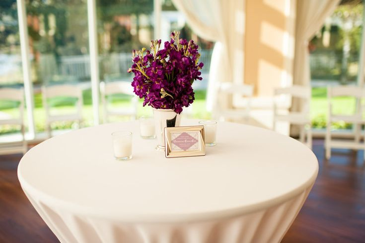 silver julep cup filled with purple stock and votives for cocktail reception tables.