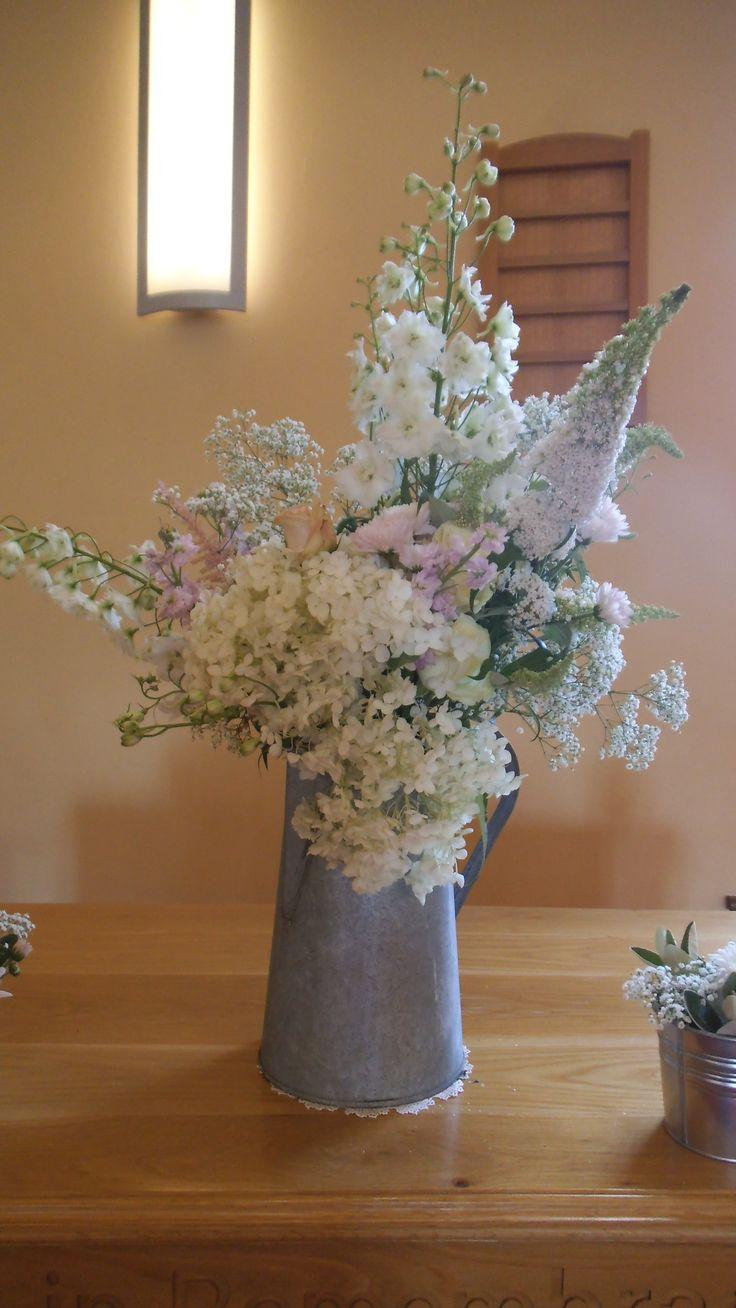 galvanised jug full of pastel flowers