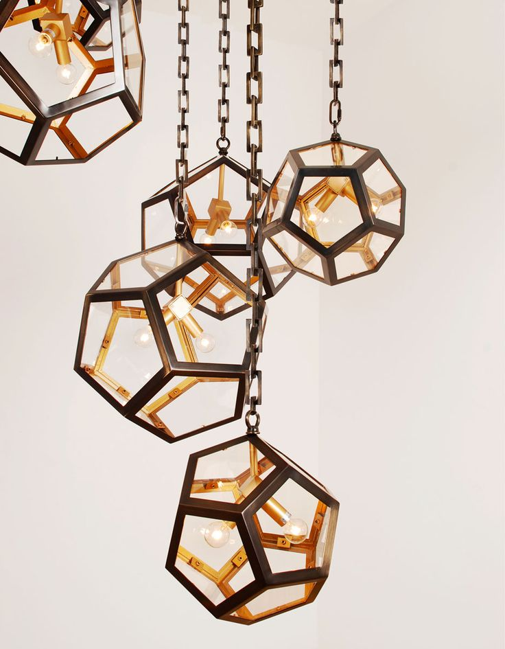 Pentagram globes with glass panels, painted bronze and gold. Custom Lighting from Lukas Lighting.