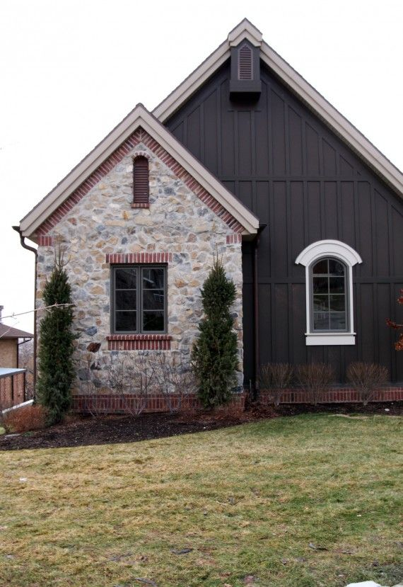 Cottage rustic. Board and batten. Brick and stone.