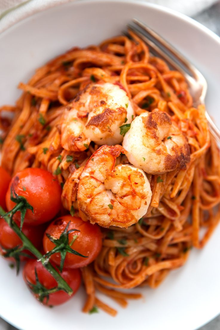 Delicious Garlic Butter Tomato Shrimp Linguine made with sautéed garlic, lots of tomatoes and buttery shrimp.  A simple but stunning pasta dish!