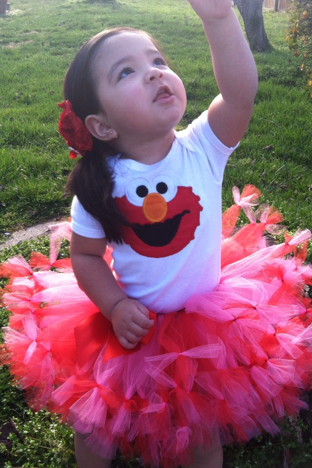 Gorgeous elmo tutu with shirt/onesie personalize (also available other colors). $42.00, via Etsy.
