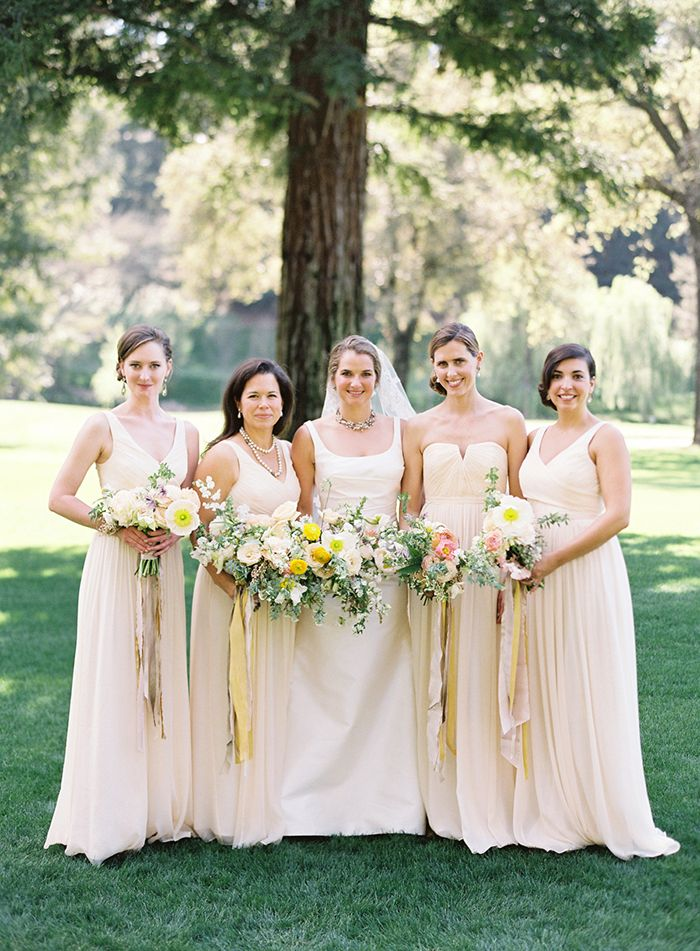 Pastel Peach and Yellow Bridesmaids