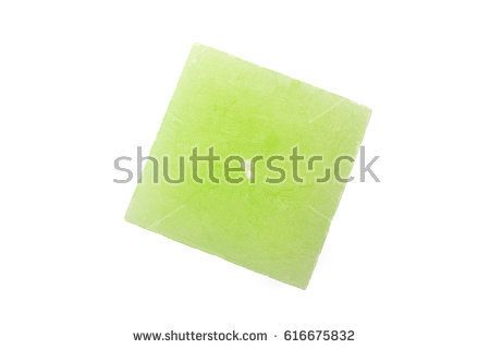 Green candle cube-shape on white background