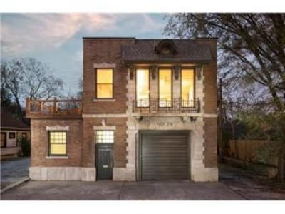 This is a gorgeous refurbished 1913 firehouse for sale in Kansas City. Custom cabinets and woodwork, beautiful tile baths. Of course, 5-car attached garage!Pretty cool! Not sure how great the neighborhood is, but cool!