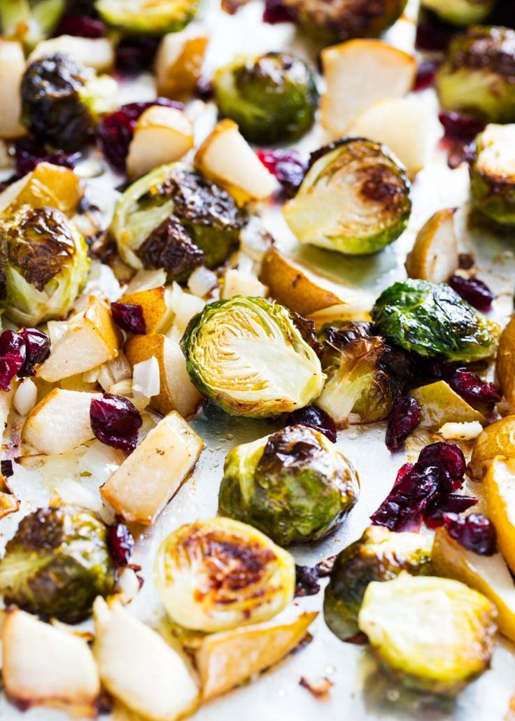 Roasted Brussels Spouts with Pears, Cranberries, and a Honey glaze! These are the best recipe I've ever had for brussels sprouts!