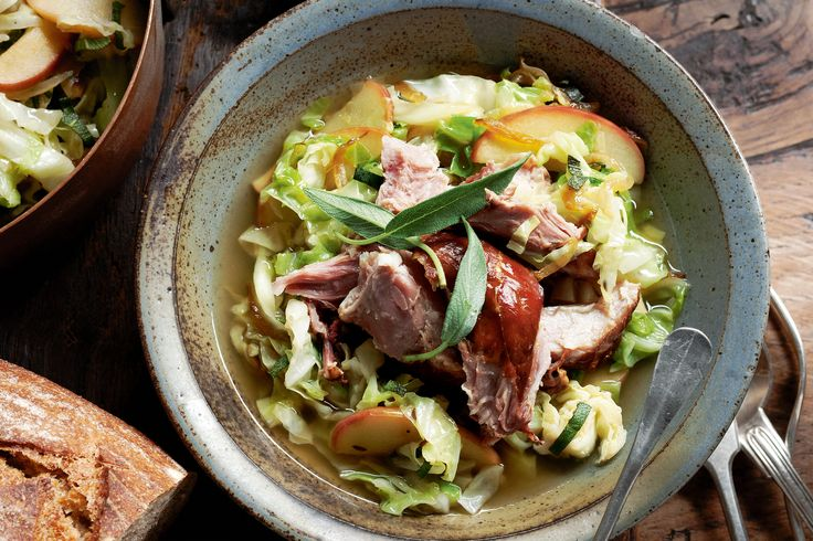 Here's a classic German combo: smoky ham slowly cooked until it's meltingly soft and ready for a bed of tender cabbage and sweet apple.