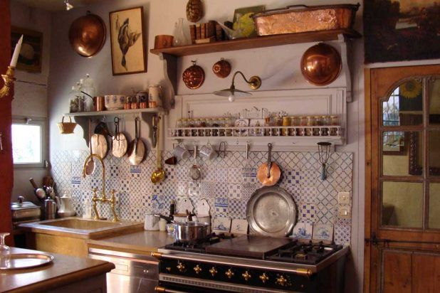 Classic french country kitchen using blue white ceramic in wall and brown wooden glass door also black stove design that have sink curved steel faucet complete modern small lamp in the night ideas
