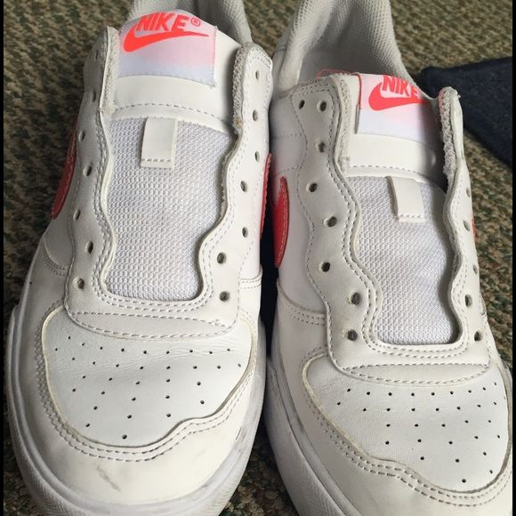 Woman's Nike sneakers White and pink, woman's Nike sneaker. Have been worn but not much. Nike Shoes Sneakers