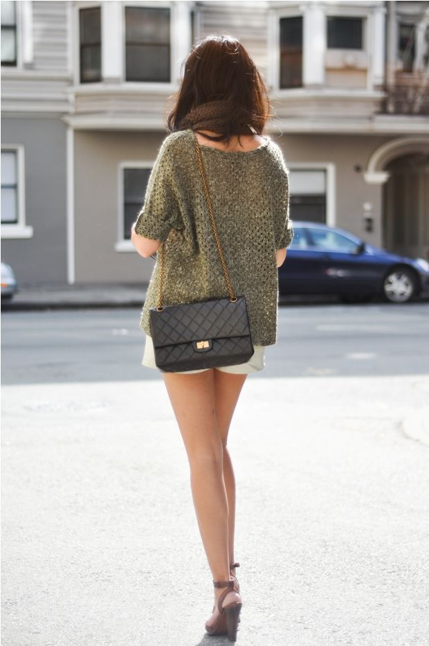 girl in street carrying a stunning chanel 2.55 reissue classic flap bag in black - bag and gold chanel 2.55 handbag