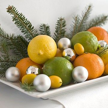 Another ornament idea - citrus fruits and ornaments - perfect for a kitchen island or breakfast table (photo compliments of Home Jelly blog)