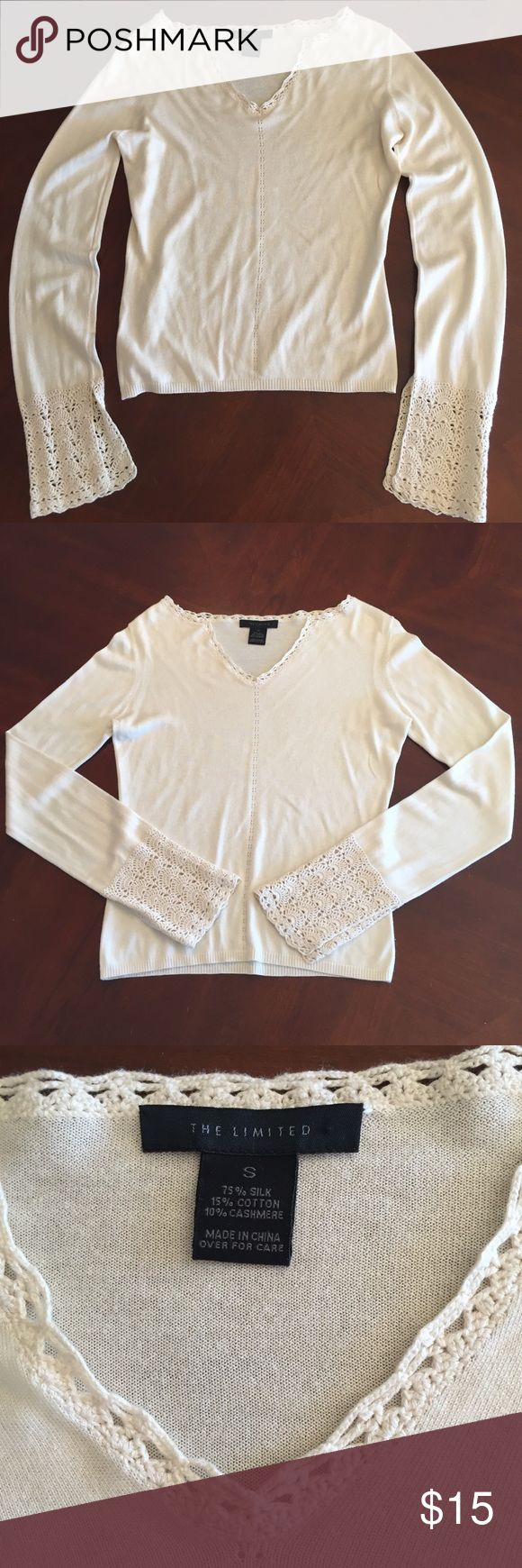 The Limited brand sweater, GUC. V-neck, off-white colored sweater from The Limited. Crochet  like detailed trim at end of sleeves with a slit on one side. Made of 75% silk, 10% cashmere, and 15% cotton. GUC, no stains or tears. The Limited Sweaters V-Necks