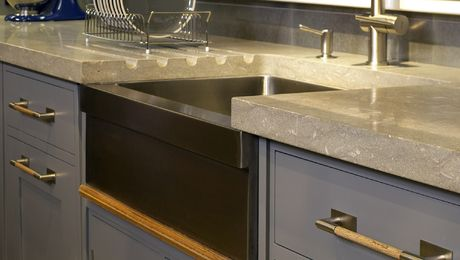 Use your countertop to have a cleaner more minimalist kitchen. Insert sloped groves into the countertop and eliminate the need for an ugly drain board!
