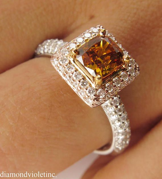$6500 This breathtakingly beautiful Estate Vintage 18k Multi-Tone Gold Engagement Ring (stamped). The Center Diamond is GIA Certified 1.05ct Cushion cut in Beautiful NATURAL Fancy Brownish Yellowish Orange color, SI2 clarity (eye clear). Rich Saturated Super Brilliant light Cognac color! It is set into Diamond Pave Halo and accented with diamonds on the band. There are small White and Yellow round Diamonds, estimated total weight is 0.89CT, G- H color, SI2-I1 clarity overall. The diamonds…