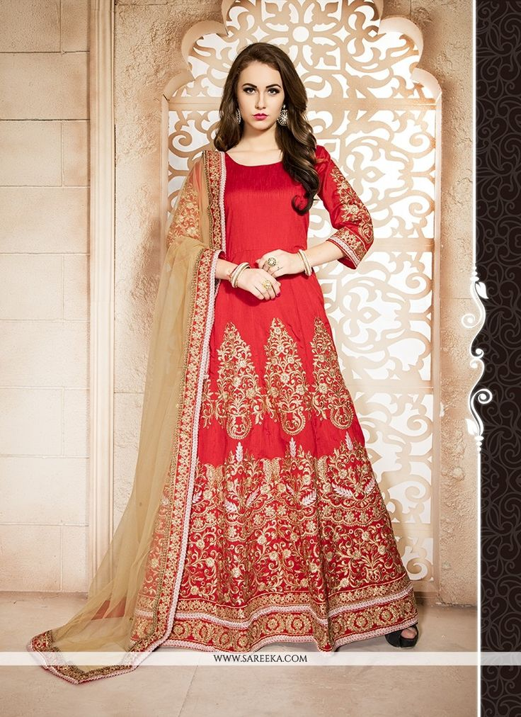 Include yourself in a glamour of a season with this red banglori silk designer floor length suit. The fantastic attire creates a dramatic canvas with unbelievable embroidered and resham work. Comes wi...