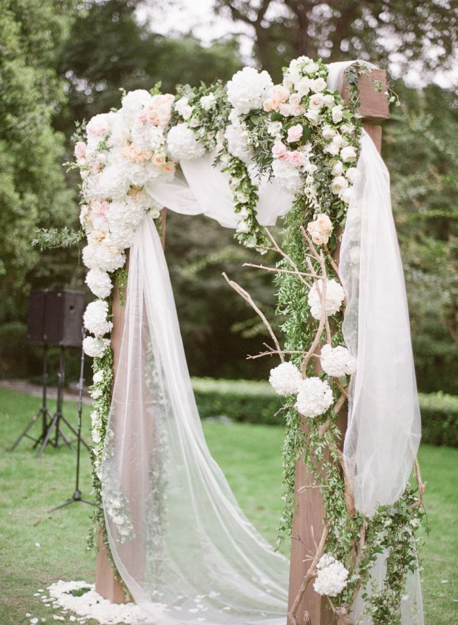 Ceremony arbour with beautiful drapery and fresh florals #ceremony #wedding #love #florals #drapery