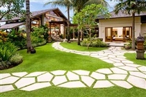 Bali style garden, notice lack of garden edging and still opportunity for large areas of lawn.