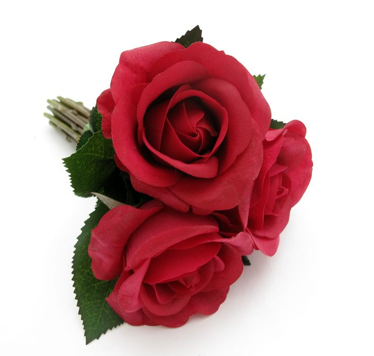 A flower girl's posy of red Fresh Touch roses.