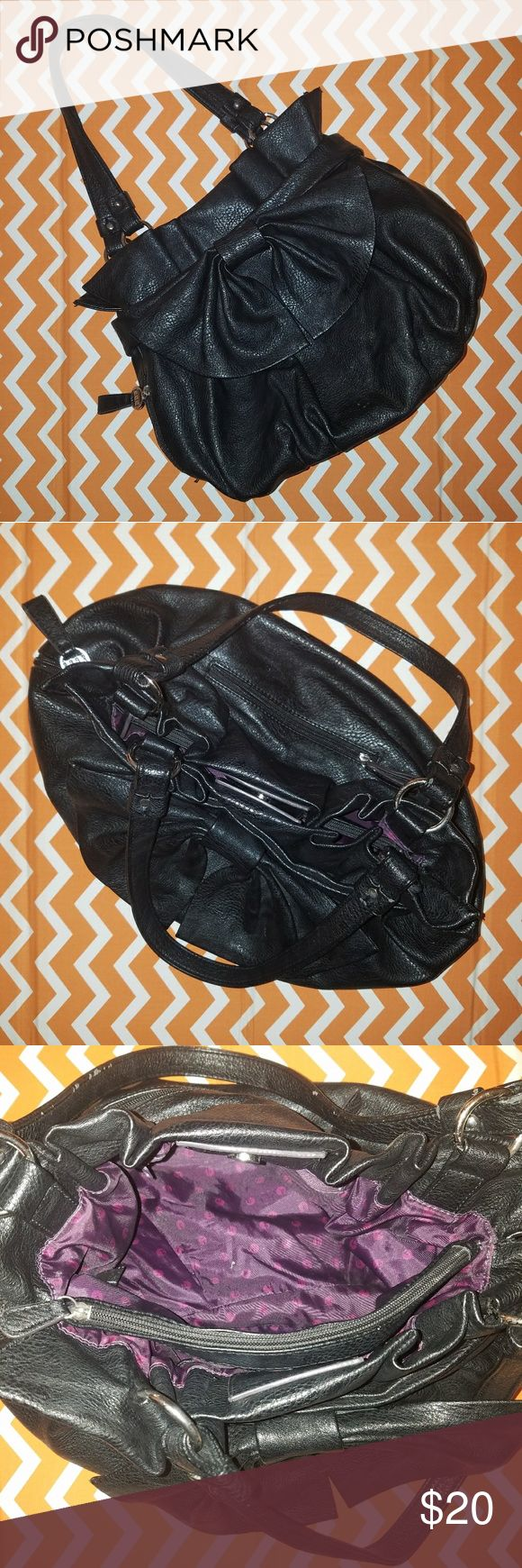 Black Bow Slouchy Hobo Purse by Elle Cute black bucket bag with big bow on front. Has 2 zip pockets on the outside - 1 on back and 1 on side. Inside is lined with purple polka dot fabric and has 2 main pockets with 1 big zip pocket in the middle, 1 small zip pocket on one side, and 2 open pockets on the other. Gently used, good condition!  Please feel free to make me an offer on one or more items! Bundle discount of 15% will be automatically applied to 2+ items! :) Elle Bags Hobos