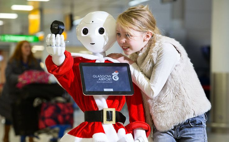 Glasgow Airport Has a Robot That Sings Christmas Carols to Travelers