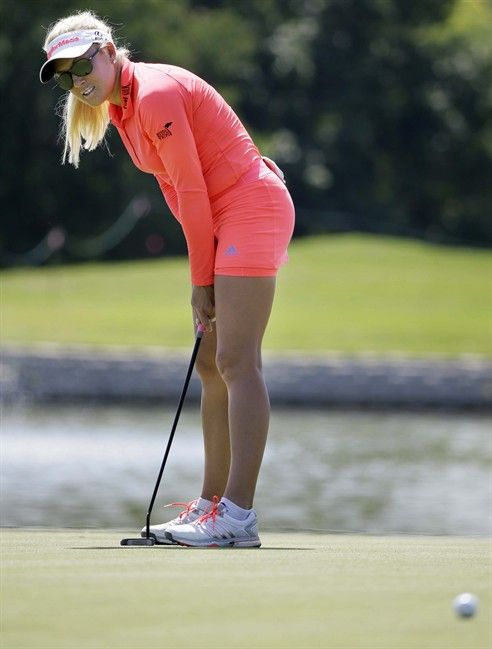 Natalie Gulbis just misses a putt on the 11th hole during the second round of the LPGA North Texas Shootout golf tournament, Friday, May 1, 2015, in Irving, Texas. (AP Photo/LM Otero)