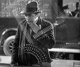 M (1931 film) - Peter Lorre as Hans Beckert, gazing into a shop window. Fritz Lang uses glass and reflections throughout the film for expressive purposes.