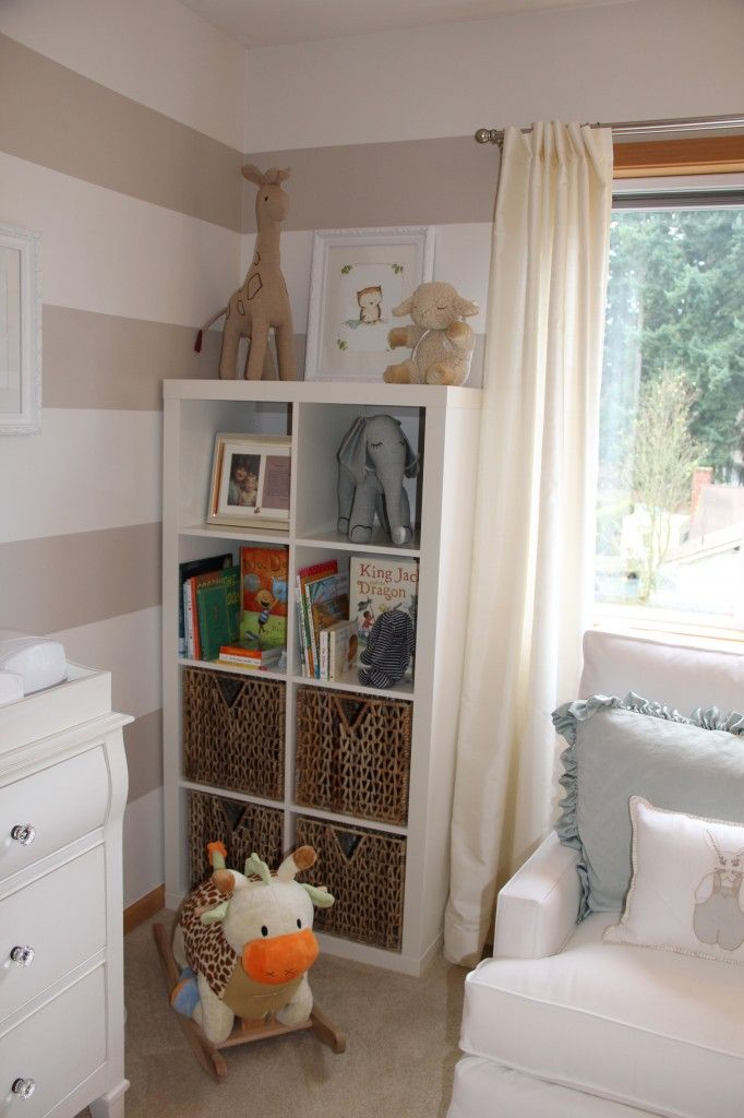 love the mix of jungle and barnyard animals in this nursery (not to mention the stripes on the walls and neutral color palate)
