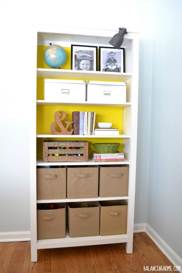 Ikea Hemnes Bookshelf.  Use foam board covered in wrapping paper to add a pop of color without commitment.