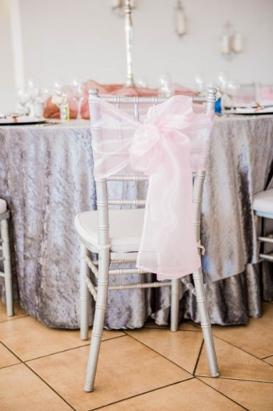 Monte Vista Venue silver tiffany chairs with a pink tieback for a pink and brown wedding