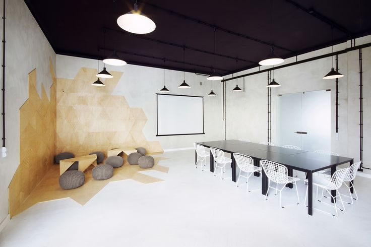 Partition walls were removed in order to create the two required spaces, and within the two rooms the designers have carefully reinterpreted the same shapes and elements to create a connection between the pair.