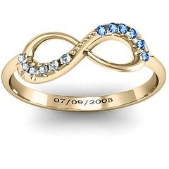 Infinity symbol with his and hers birthstones with dating anniversary engraved on the inside. Perfect.