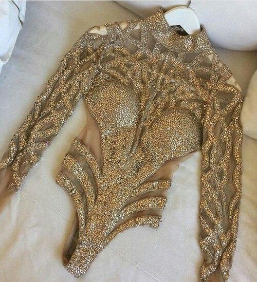 Golden sequin bodysuit.                                                                                                                                                                                 More