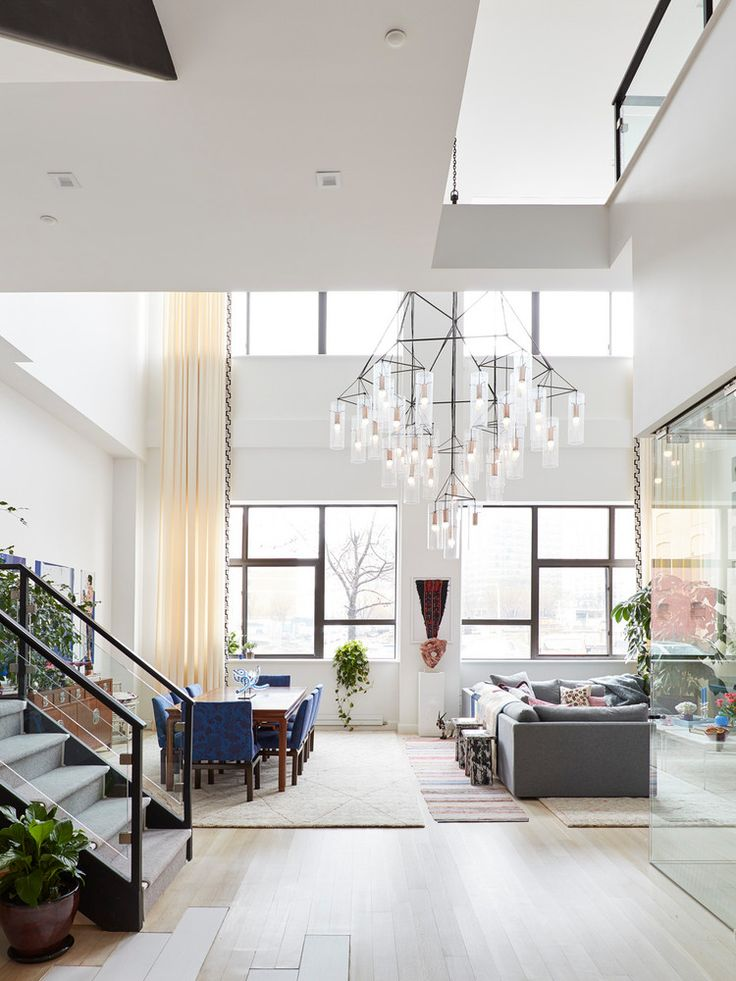 Oversized lighting fixture in a high ceiling loft